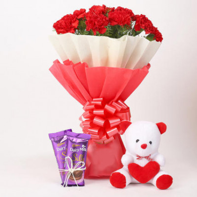 12 Red Carnations with Dairy Milk Silk & Teddy Bear